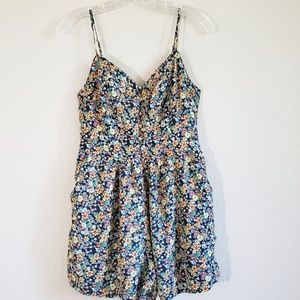 Floral romper by One love clothing Los Angeles